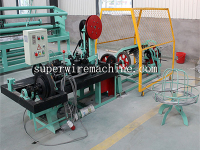 Barbed wire manufacturing machine